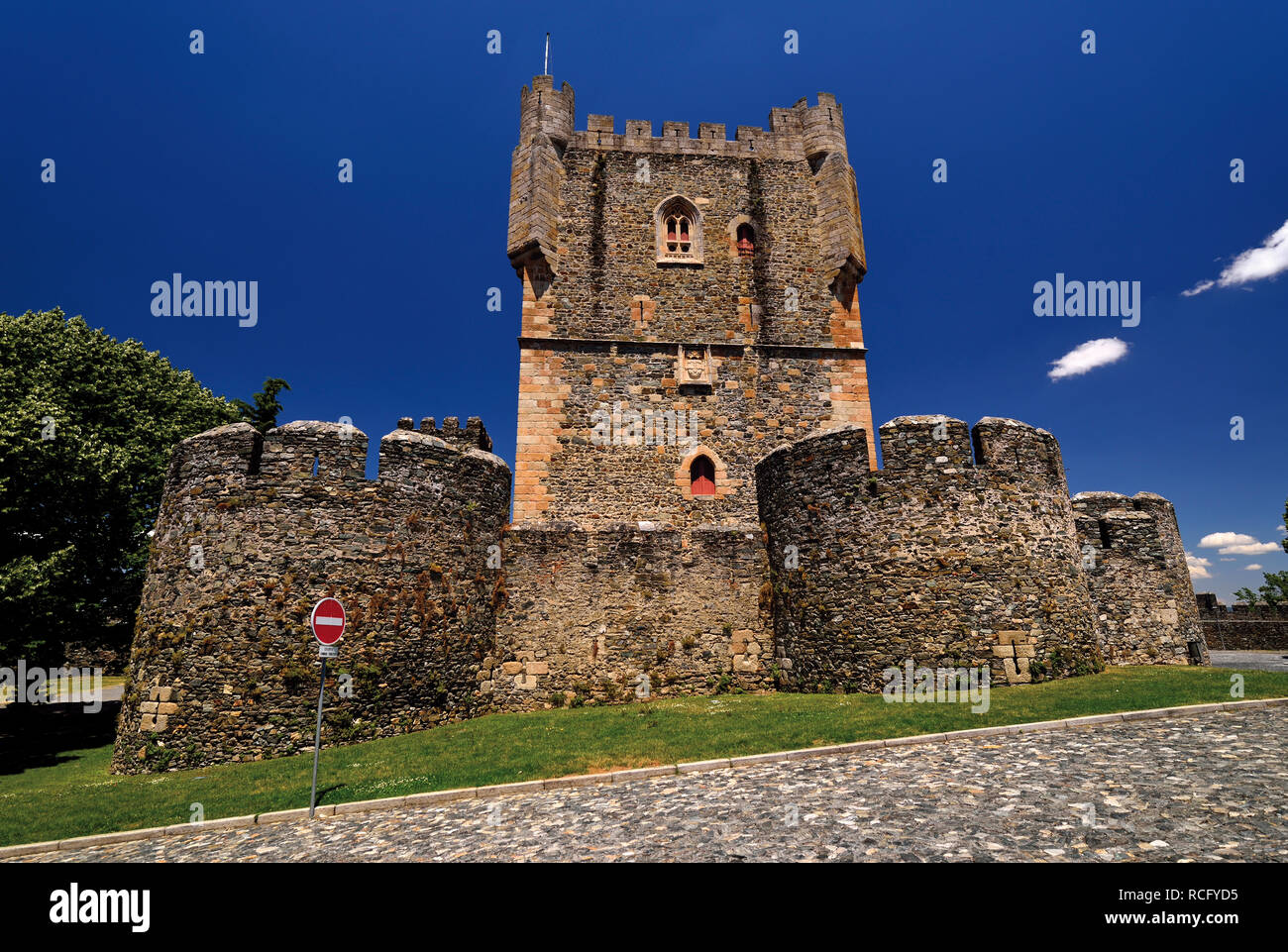 Medieval castle with square and cylindric towers - Stock Image