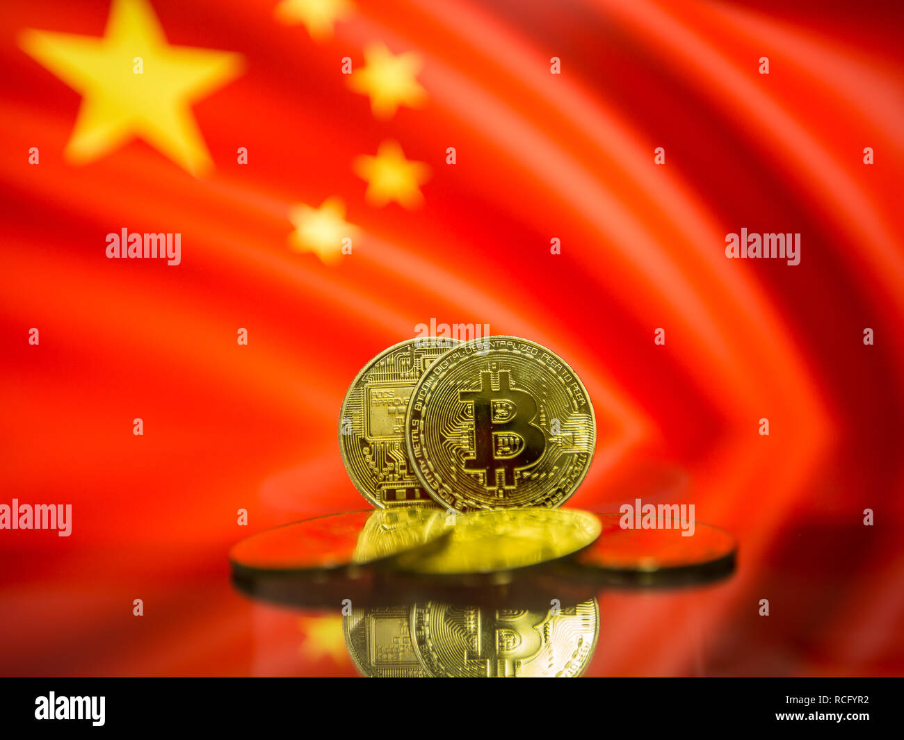 Bitcoin gold coin and defocused flag of China background. Virtual cryptocurrency concept. Stock Photo