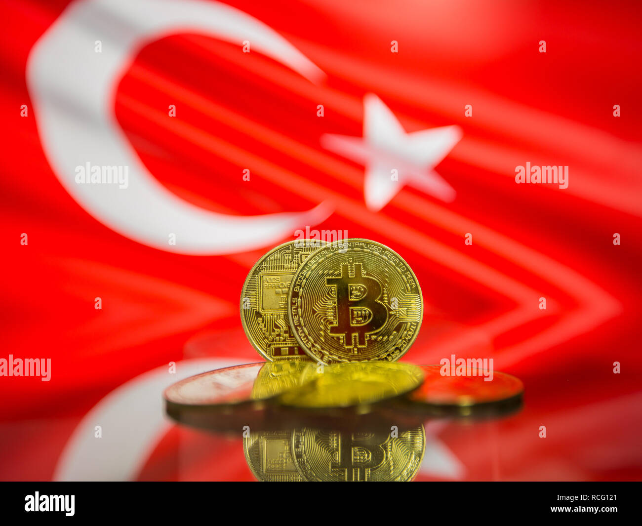 Bitcoin gold coin and defocused flag of Turkey background. Virtual cryptocurrency concept. Stock Photo