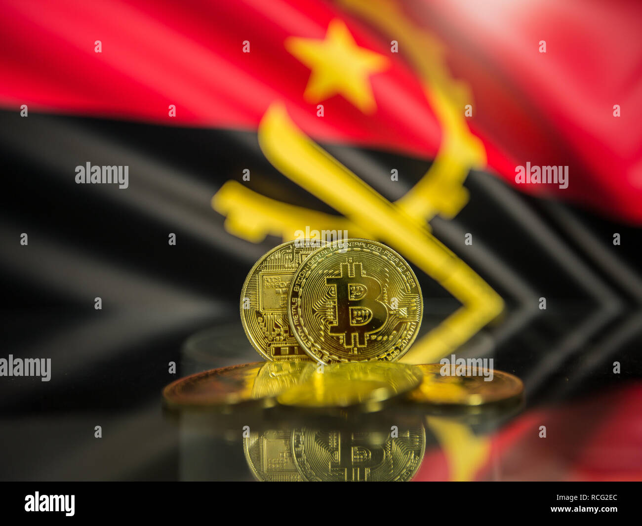Bitcoin gold coin and defocused flag of Angola background. Virtual cryptocurrency concept. - Stock Image
