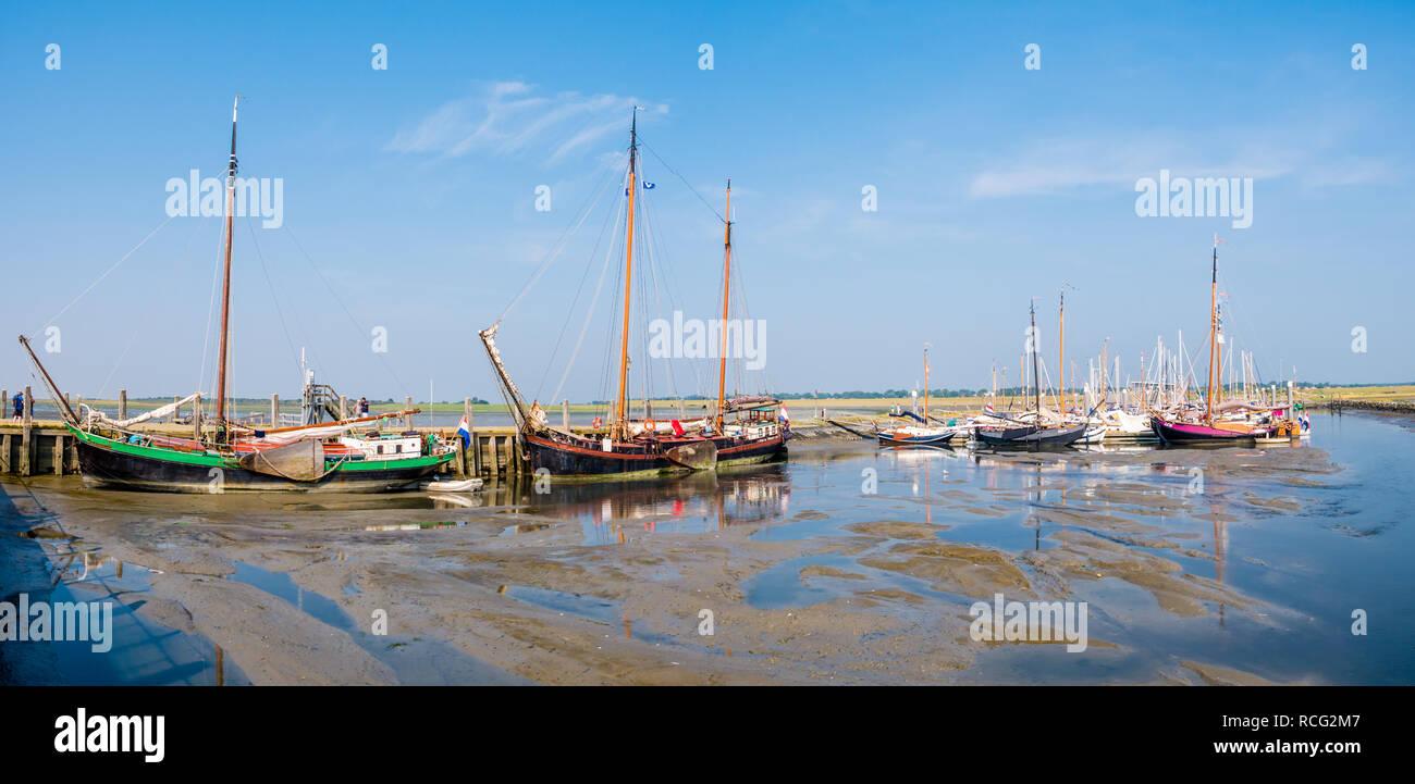 Sailing boats in marina at low tide, West Frisian island Schiermonnikoog, Netherlands Stock Photo