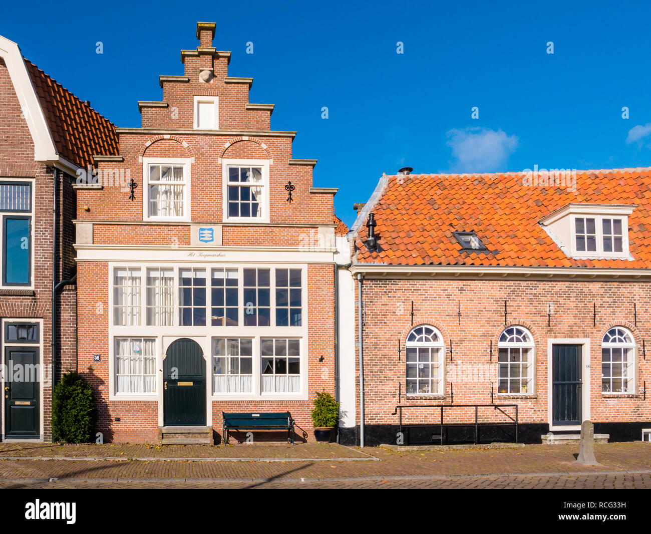 Front of historic merchant's house with stepped gable in downtown Enkhuizen, Noord-Holland, Netherlands - Stock Image