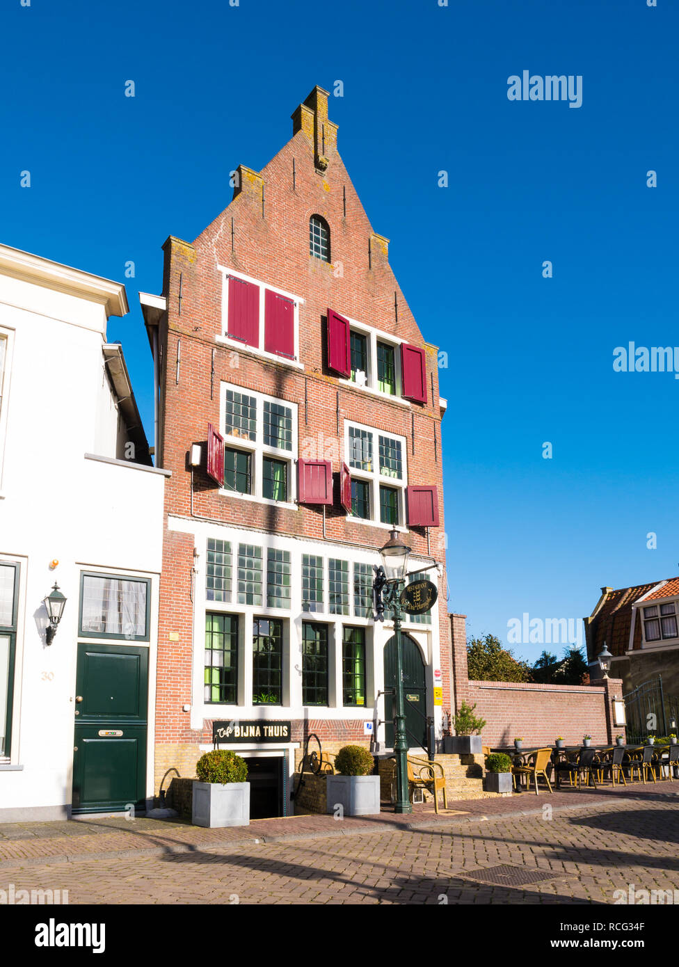 Facade of restaurant in historic warehouse in old town of Enkhuizen, Noord-Holland, Netherlands Stock Photo
