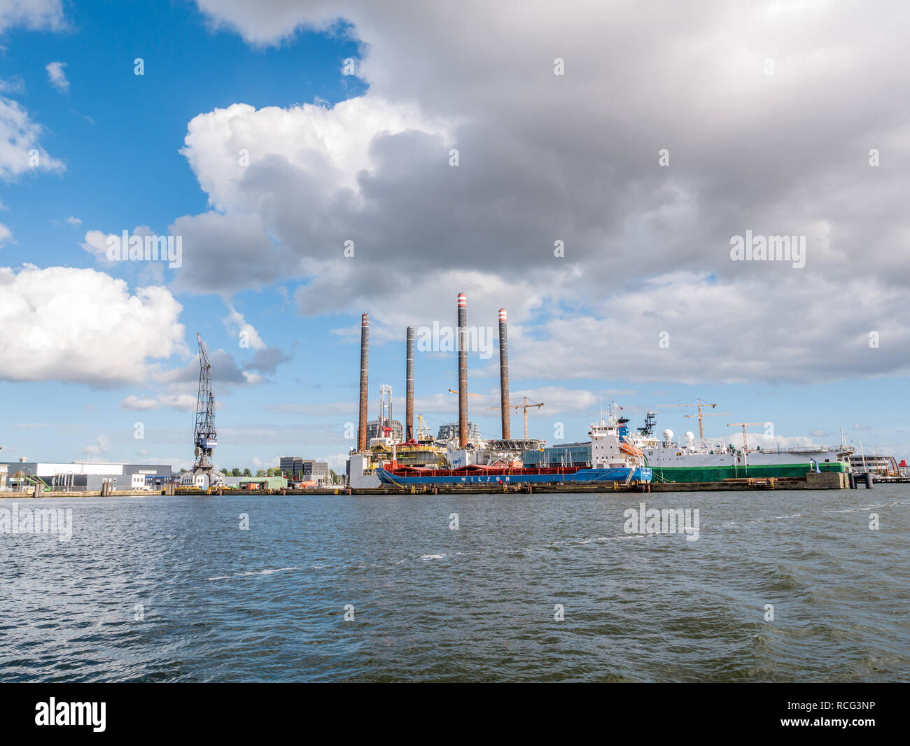Ships docked in shipyard near NDSM wharf on northern bank of IJ river in Amsterdam, Netherlands Stock Photo