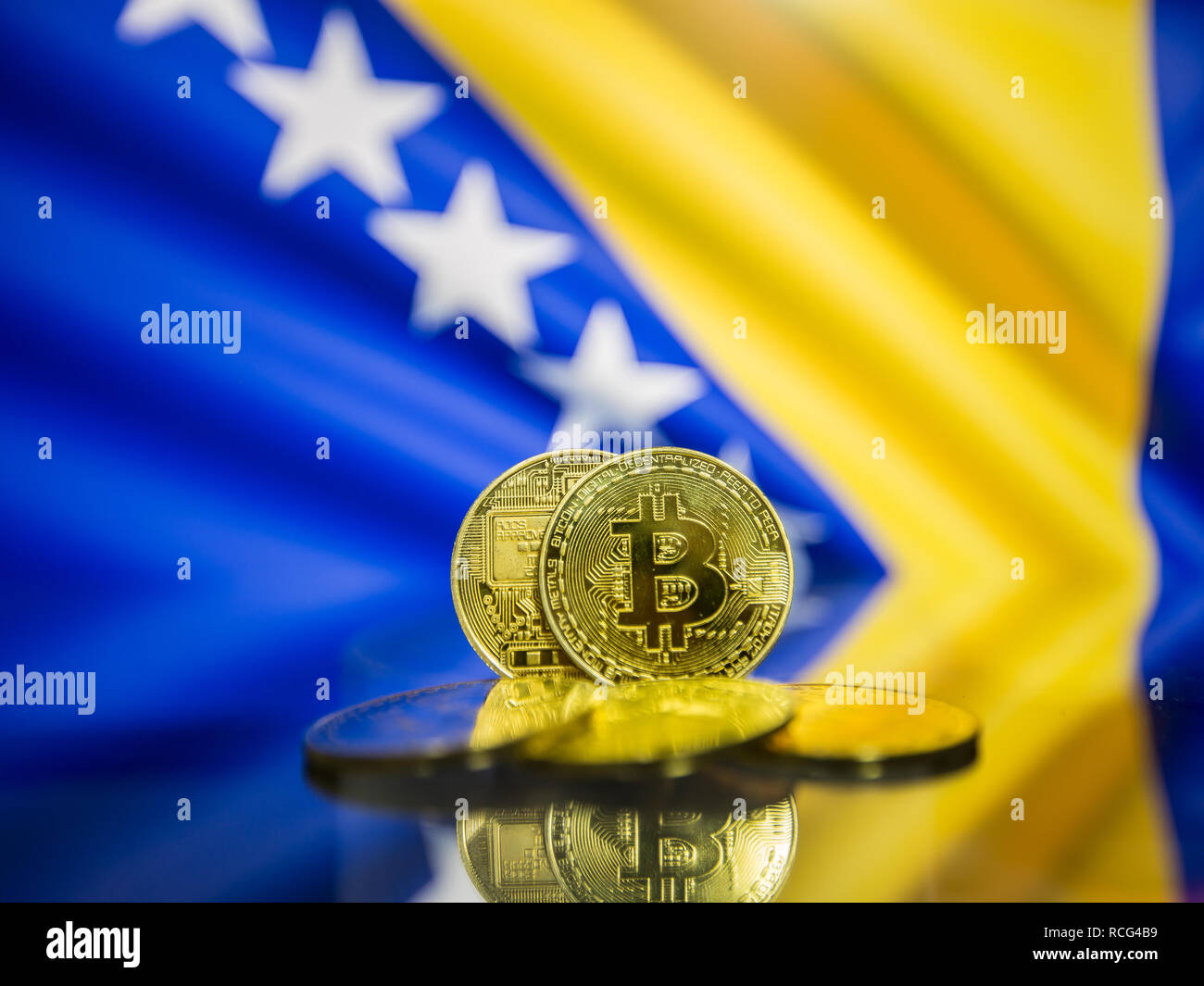 Bitcoin gold coin and defocused flag of Bosnia and Herzegovina background. - Stock Image