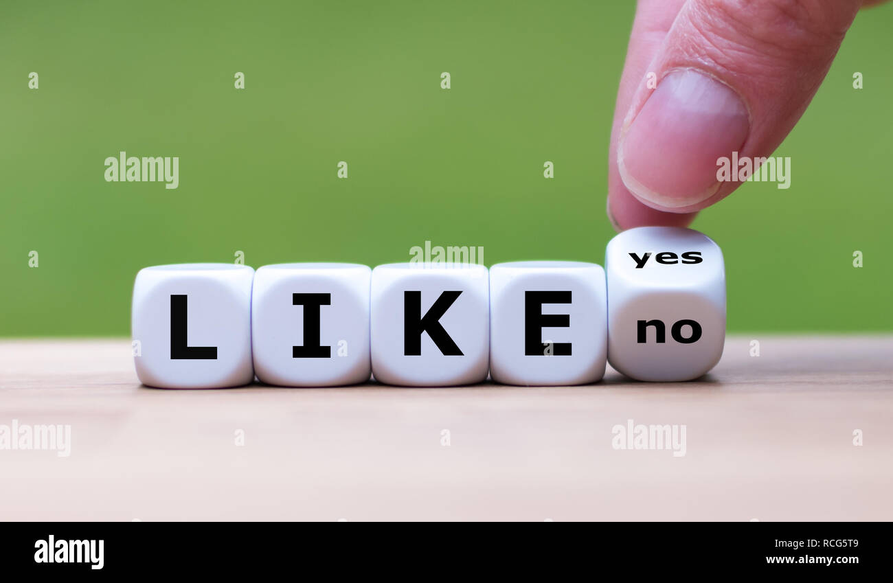 To like something? Hand turns a dice and changes the word 'no' to 'yes' - Stock Image