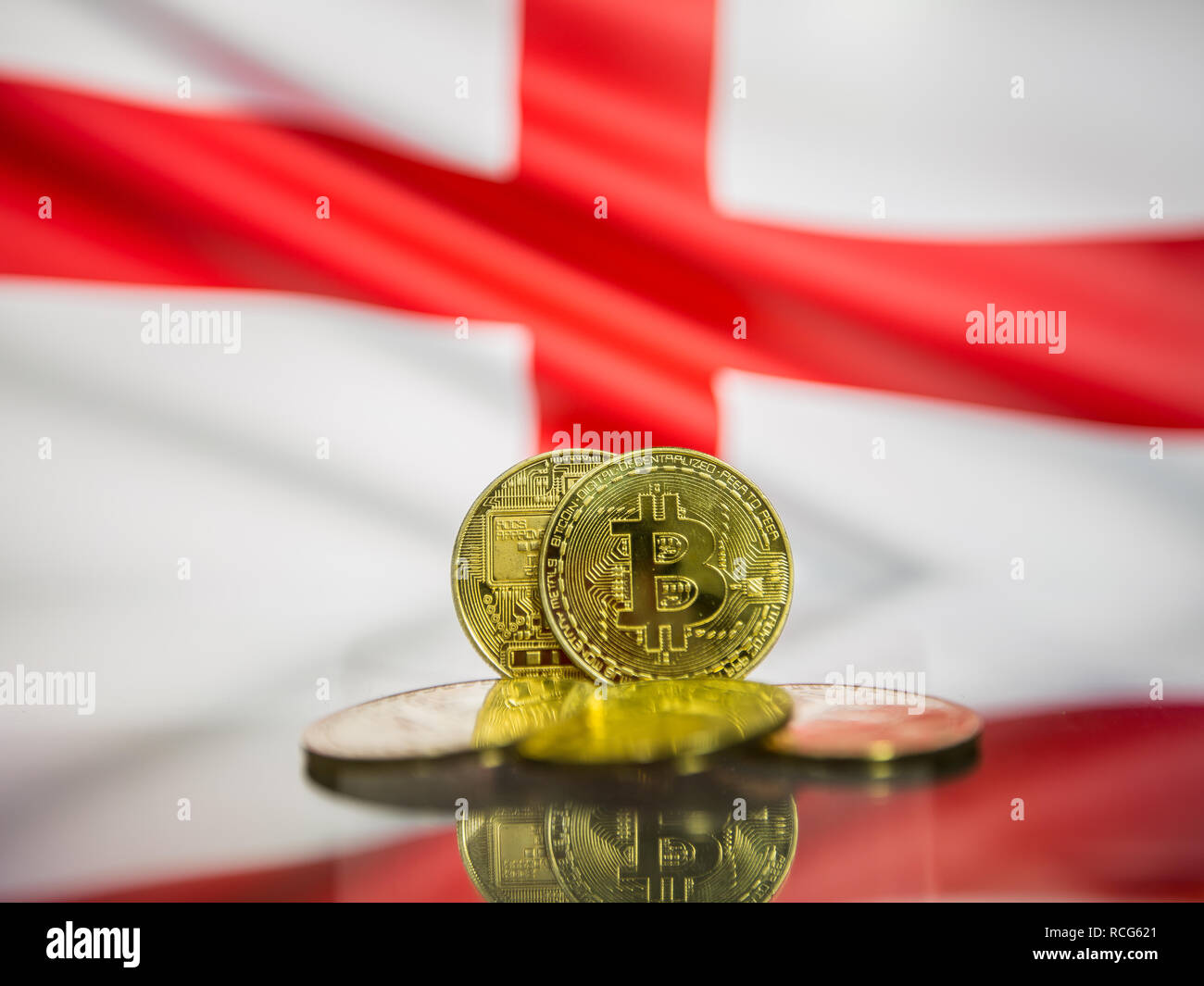 Bitcoin gold coin and defocused flag of England background. Virtual cryptocurrency concept. Stock Photo