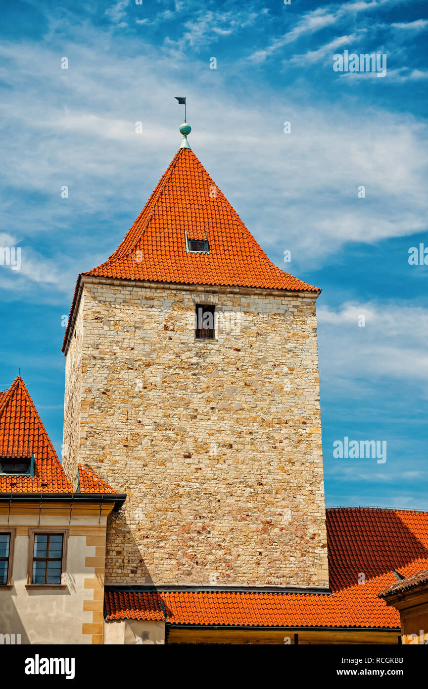 Stone tower with terracotta roof in Prague, Czech Republic, on sunny day on blue sky background. Landmark, sightseeing, travelling, wanderlust, vacation concept. - Stock Image