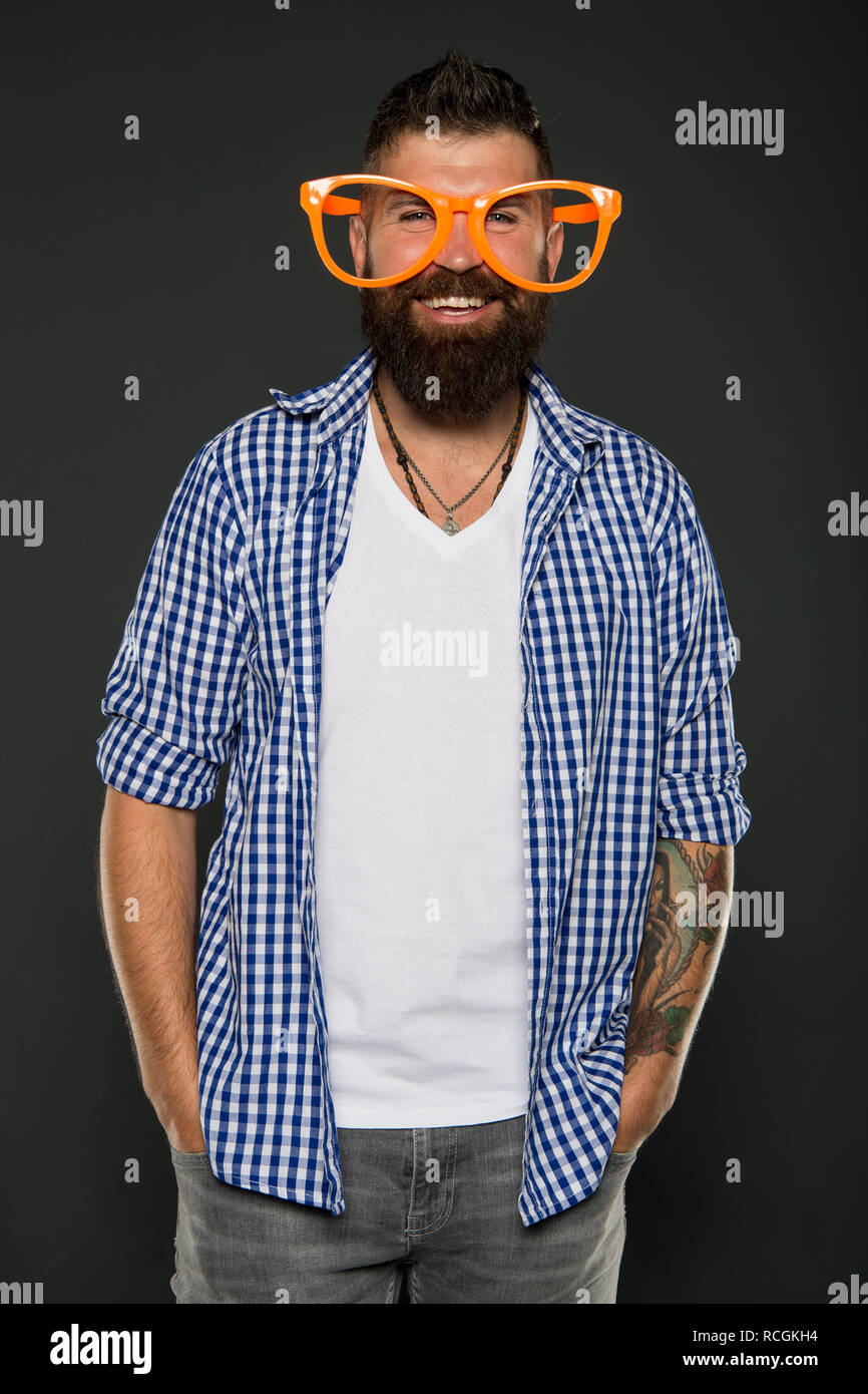 Stay positive. Man brutal bearded hipster wear funny eyeglasses accessory. Human strengths and virtues. Positive mood. Positive psychology. Overcome life troubles with smile. Happiness and positive. - Stock Image