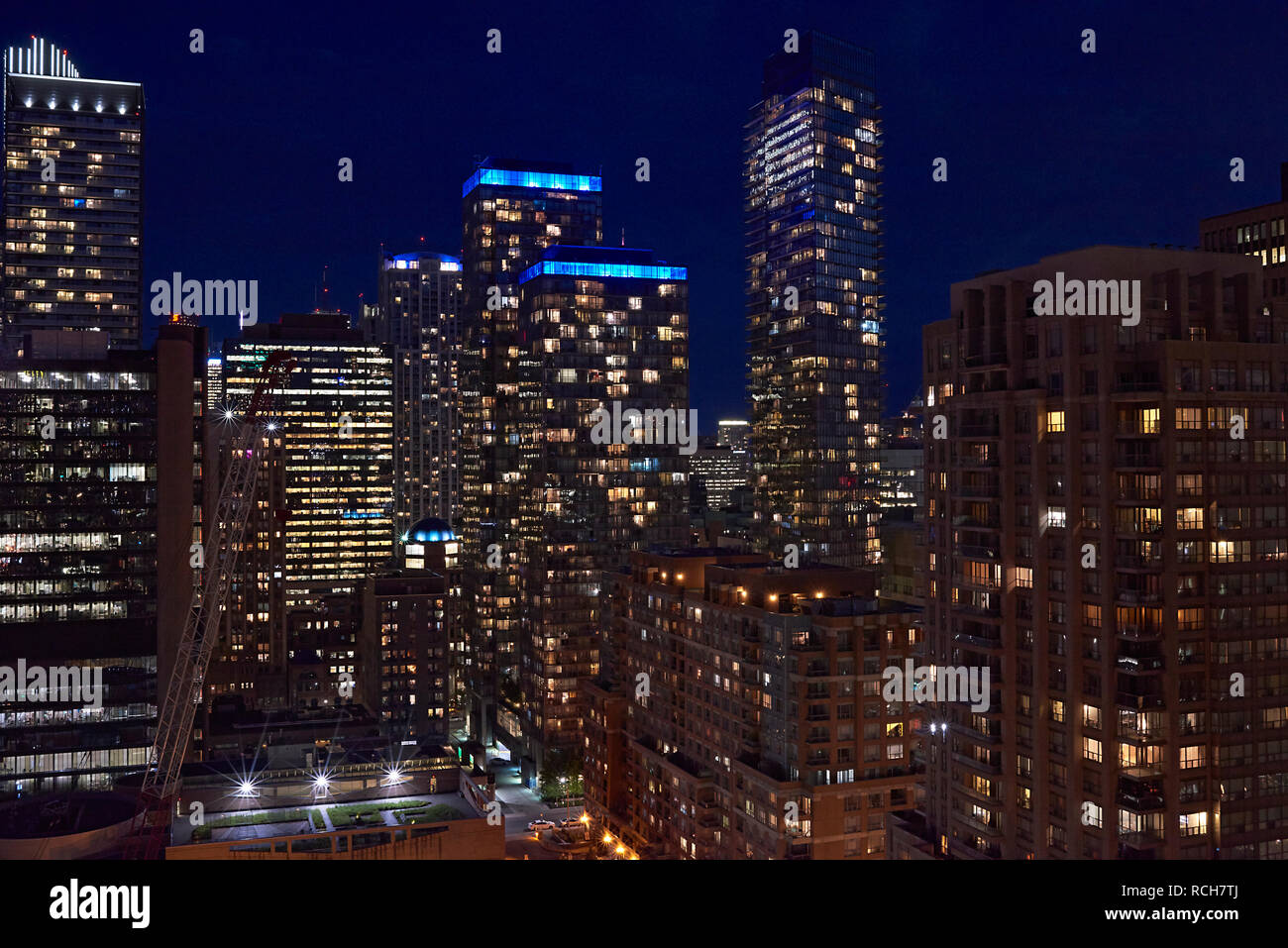 View of the business district and its skyscrapers is in Toronto city at night - Stock Image