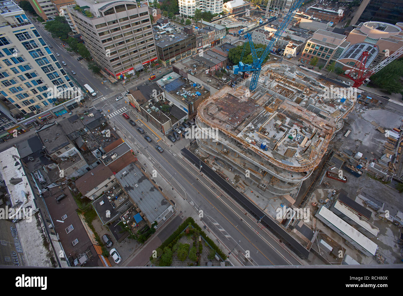 HIgh angle view looking down onto the streets of Toronto city centre and a construction site - Stock Image