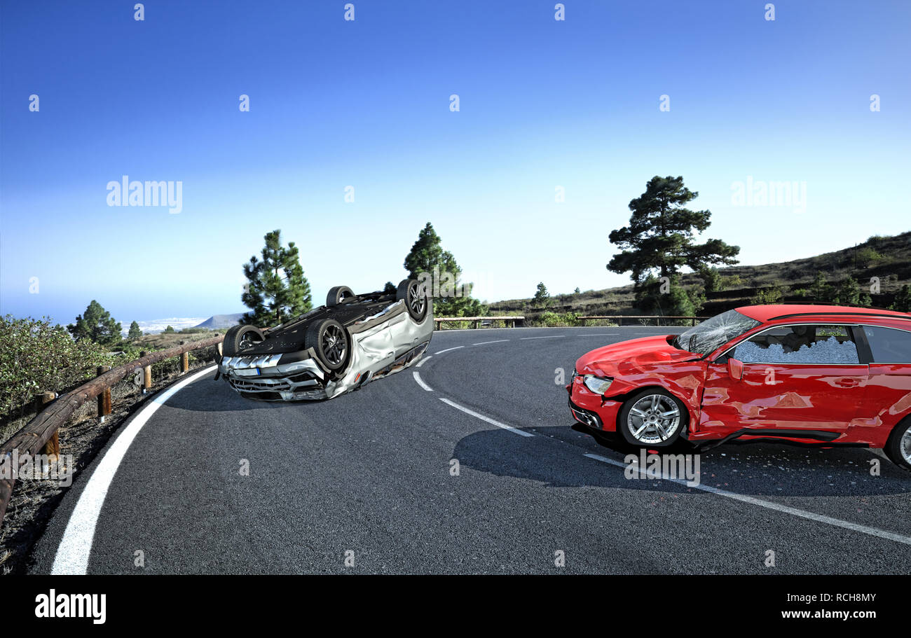 Two cars accident. Crashed cars on a road in the country side location. A red sedan against a silver car upside down. Strong collision with big damage - Stock Image