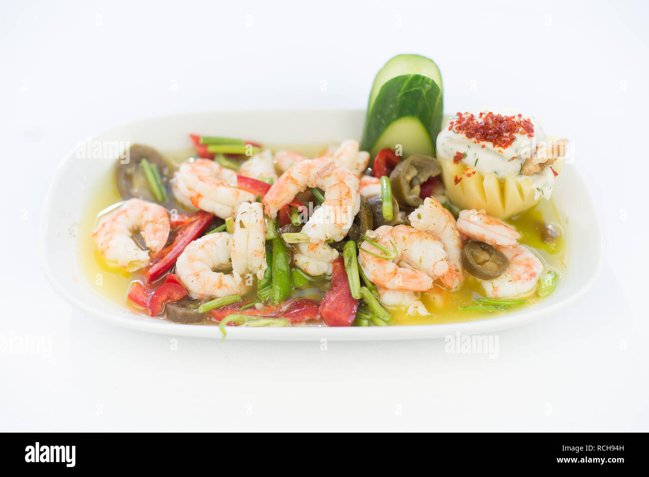 Marinated Shrimp appetizer salad. Delicious tasty yummy shrimp appetizer. Shrimp dish on isolated white background. Seafood appetizer. Stock Photo