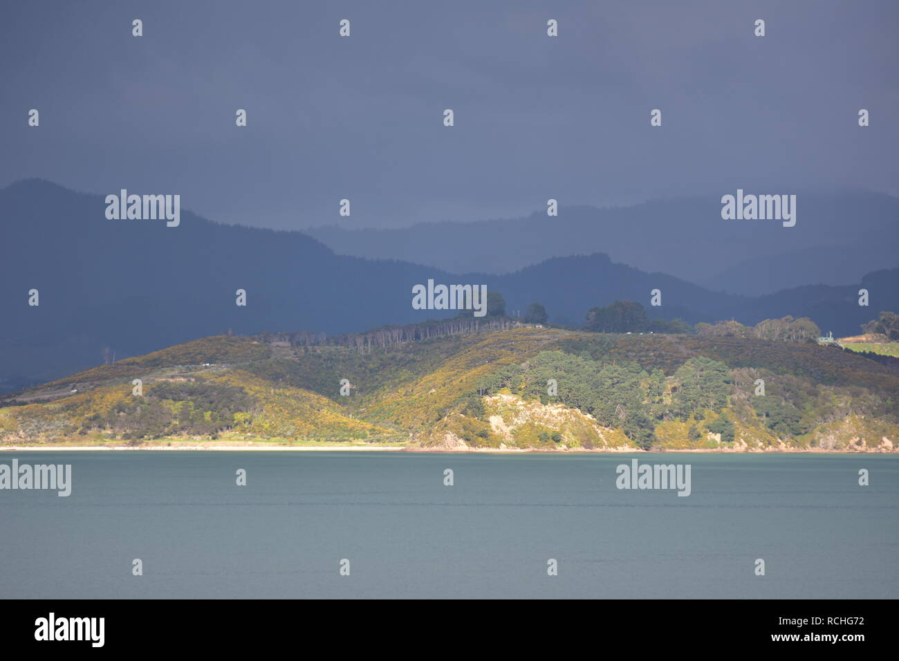 Storm coming over islands in inner Hauraki Gulf in New Zealand. - Stock Image