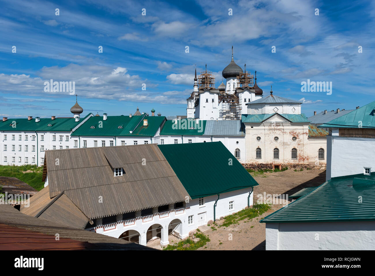 SOLOVKI, REPUBLIC OF KARELIA, RUSSIA - JUNE 27, 2018: View of the mill and the church of Philip In the Spaso-Preobrazhensky Solovetsky Monastery. Russ Stock Photo