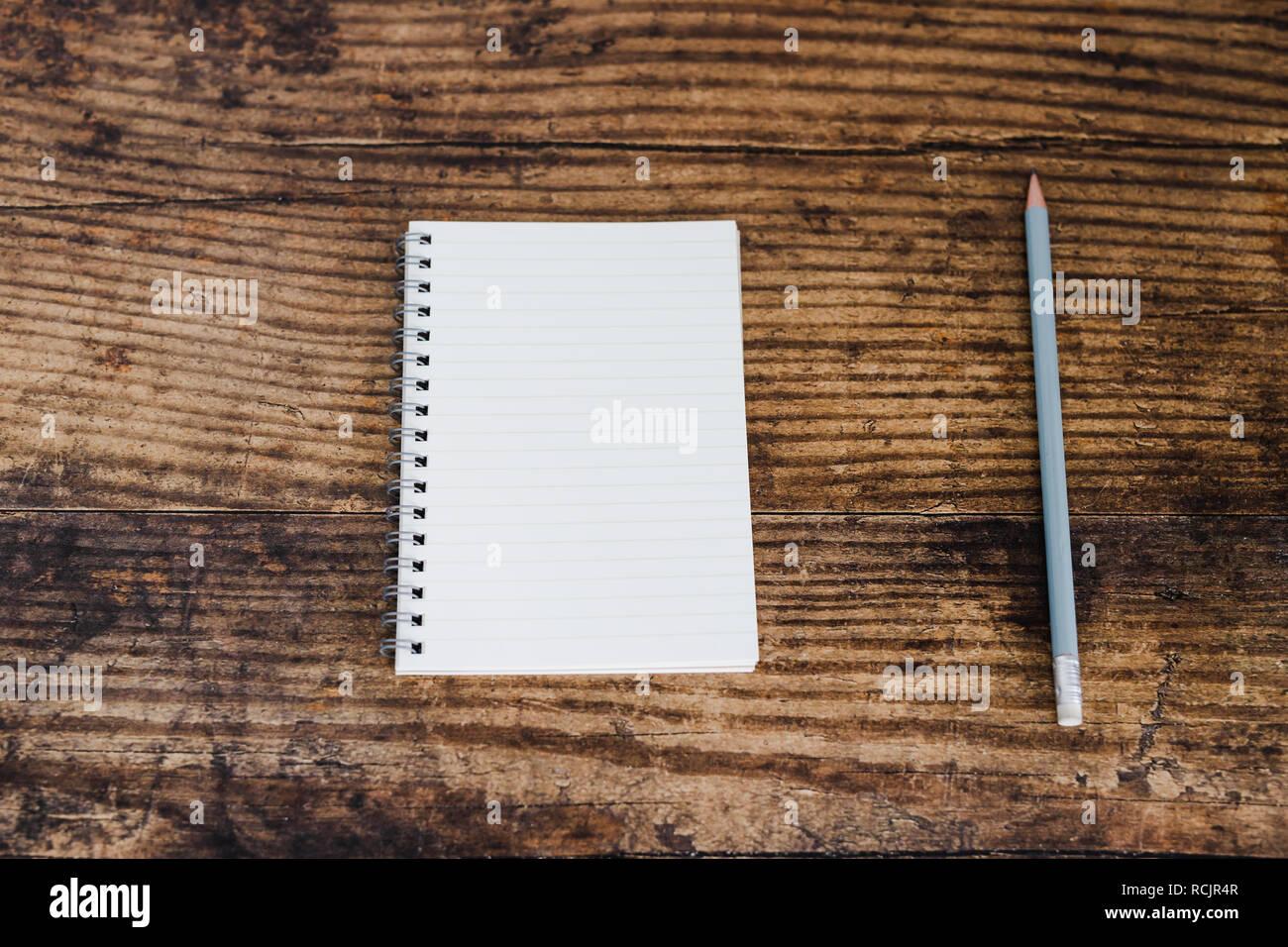 minimalist desk setting flatlay with opened ruled notepad