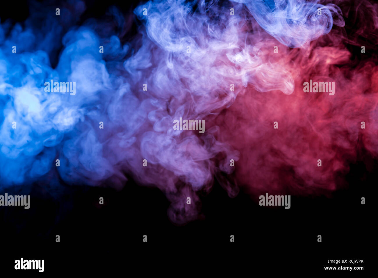 Multicolored Heavy Smoke From A Vape Of Blue And Purple Color Of The Exhaled By Scattered By Clubs On A Black Isolated Background Bright Clouds In Th Stock Photo Alamy