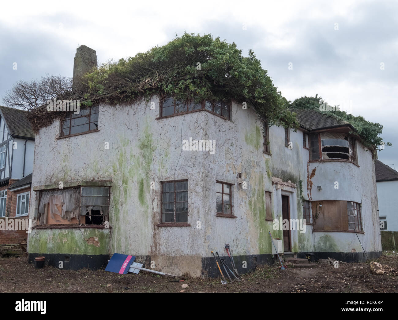 Exterior of derelict house built in 1930's deco style. House is due for demolition.Rayners Lane, Harrow, Middlesex, UK - Stock Image
