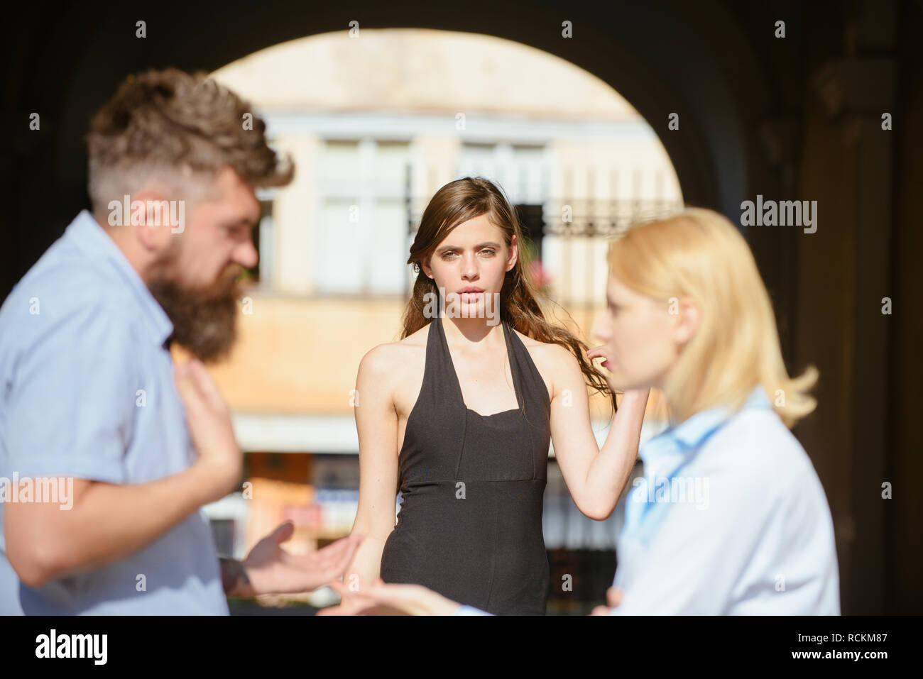 Its not my fault. Romance triangle and adultery. Jealous woman blaming unfaithful man for having a lover. Love triangle. Family conflict. Conflict in romantic relationship involving three people - Stock Image