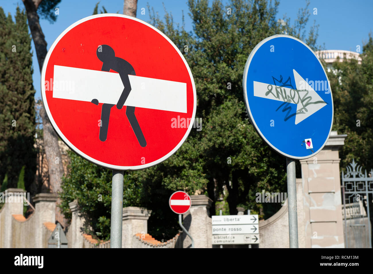 No Entry road sign defaced by street artist, Florence, Italy - Stock Image