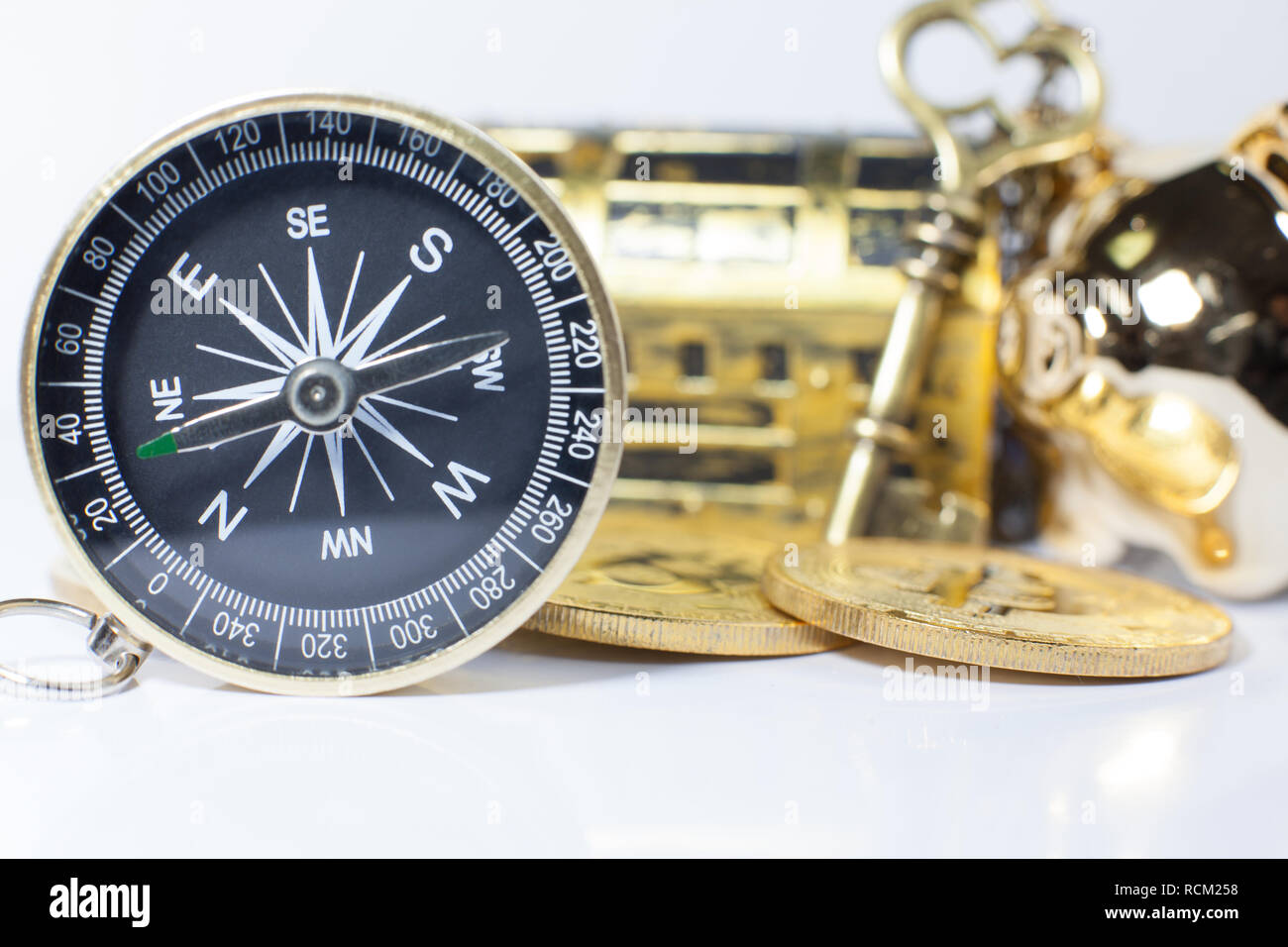Golden Compass guiding business investment, stock, money trading in right direction to wealth, rich, success, fortune. Vision, Key, Positioning, Strat Stock Photo