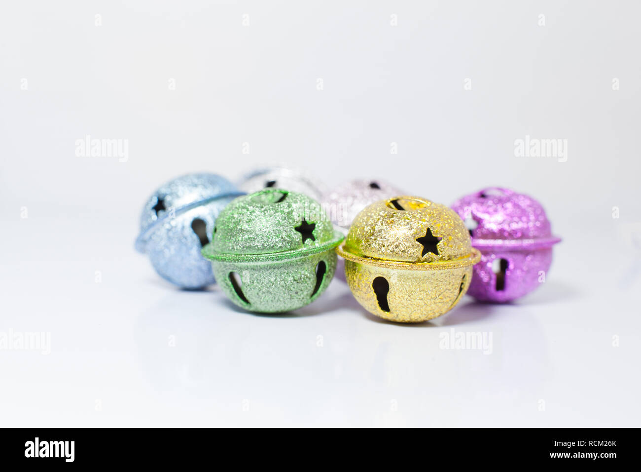 Group of Colorful painted pet small bells for cats and dogs on white background. Pet Shopping Product, Accessories, Animal Tracing Tools, Objects, Dec - Stock Image