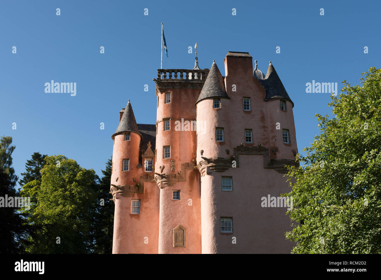 Craigievar Castle (pinkish harled facade). Excellent example of the original Scottish Baronial architecture, it was completed in 1626 by the Aberdonia - Stock Image