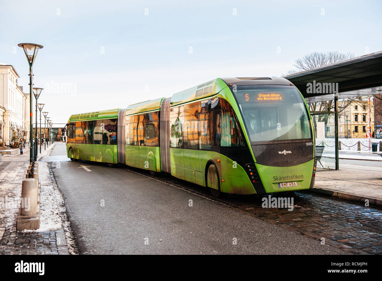 MALMO, SWEDEN - 29 DEC 2014: Modern double articulated bus Van Hool 324H Exequicity 24 Hybrid operated by Skanetrafiken arriving in bus station on a cold winter day - ecologic public transportation line 5 in Malmo  - Stock Image