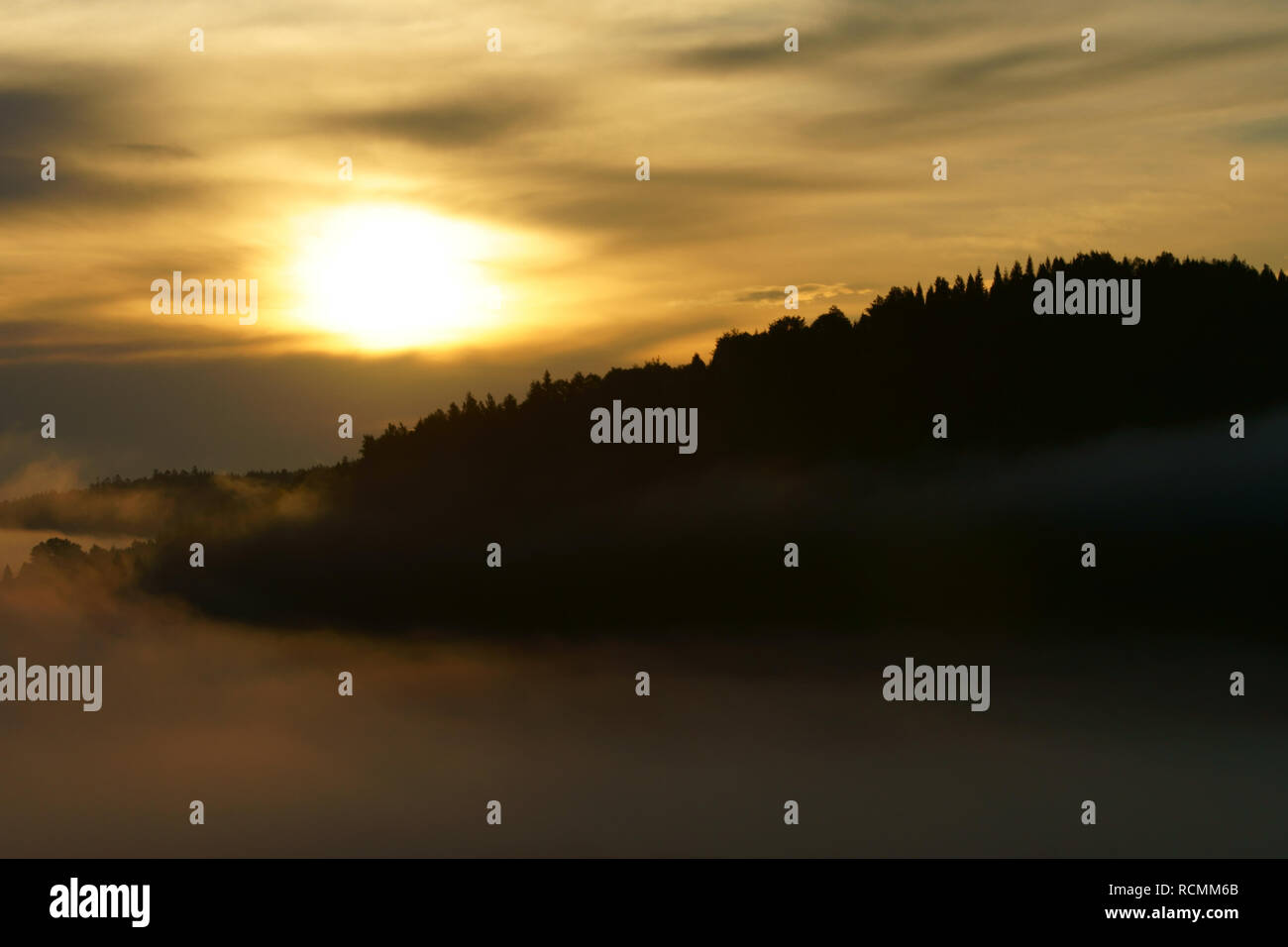 Sun, mountain and fog. Misty sunrise in the Bieszczady Mountains. Poland - Stock Image