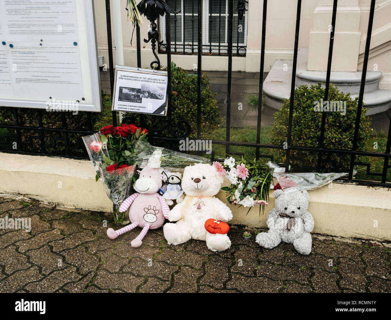 STRASBOURG, FRANCE - MAR 28, 2018: Flowers, toys at entrance of Russian Consulate Embassy mourning of victims of fire at Zimnyaya Vishnya Winter Cherry shopping centre Kemerovo Russia - Stock Image