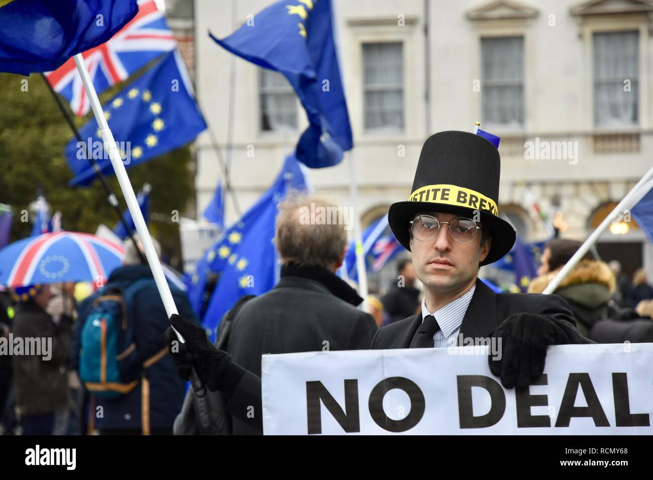 Jacob Rees-Mogg look-alike,Pro and Anti Brexit Protesters gathered outside Parliament on the day of Theresa May's meaningful vote.Houses of Parliament,Westminster,London.UK - Stock Image