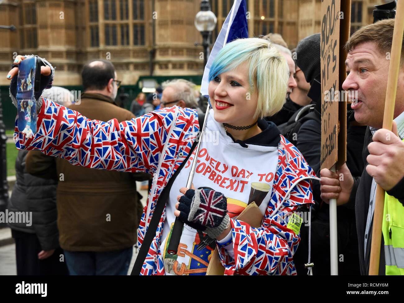 Madeleine Kay(Alba White Wolf) Pro EU Remainer with Brexiteer,Pro and Anti Brexit protesters gather outside Parliament on the day of Theresa May's meaningful vote. - Stock Image