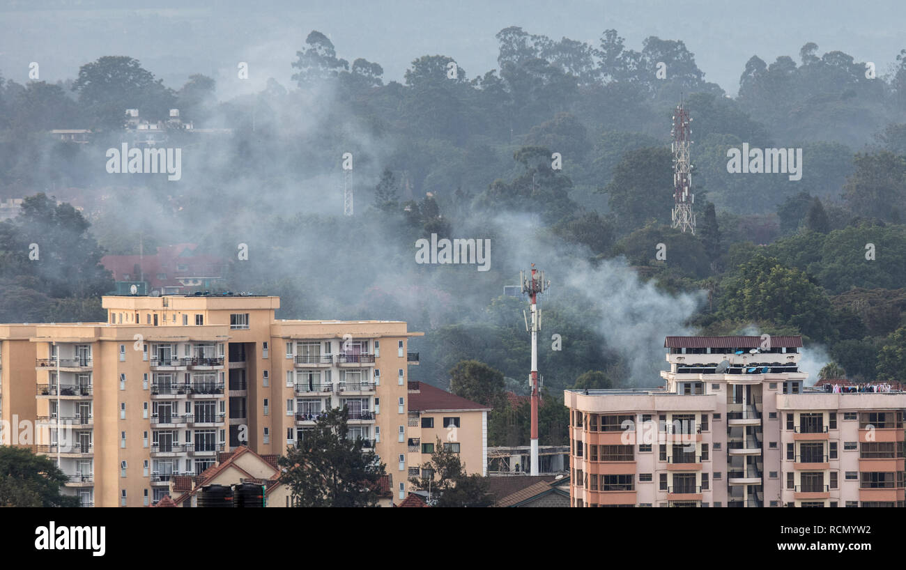 Nairobi, Kenya. 15th Jan, 2019. Smoke rises from the blast area after an attack at an upmarket hotel and office complex in Nairobi, Kenya, on Jan. 15, 2019. At least three people have been confirmed dead and several others injured following an attack at an upmarket hotel and office complex in Nairobi on Tuesday, police said. Credit: Zhang Yu/Xinhua/Alamy Live News - Stock Image
