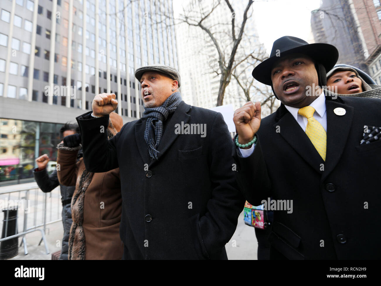 New York, USA. 15th Jan, 2019. People attend a rally to protest against government shutdown outside a federal government building in New York, the United States, Jan. 15, 2019. Dozens of federal employees and their representatives as well as activists gathered here on Tuesday to protest against the ongoing partial government shutdown, which is now the longest government closure in U.S. history. Credit: Wang Ying/Xinhua/Alamy Live News Stock Photo