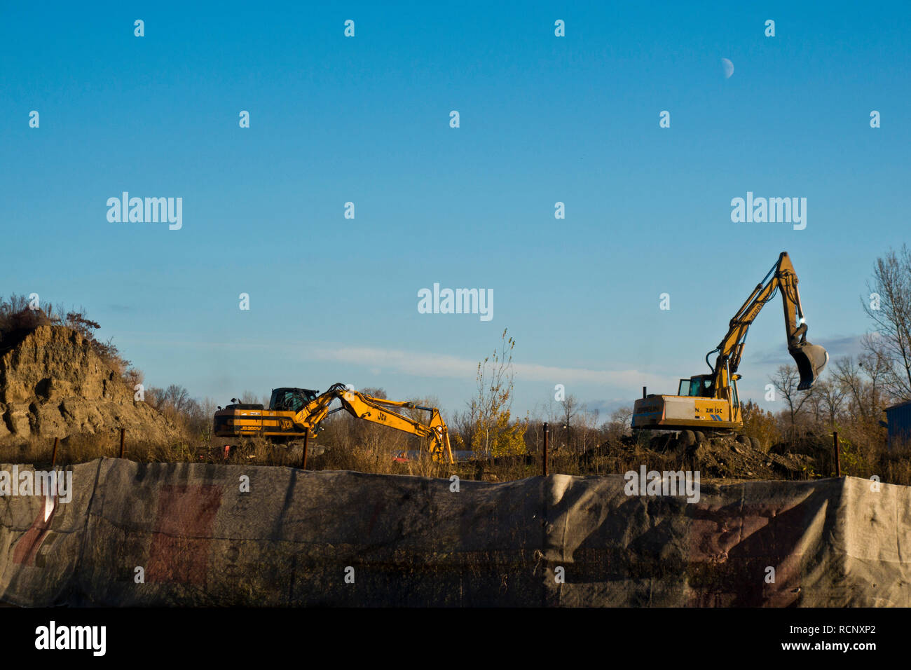 excavators at a construction site, excavating the ground - Stock Image