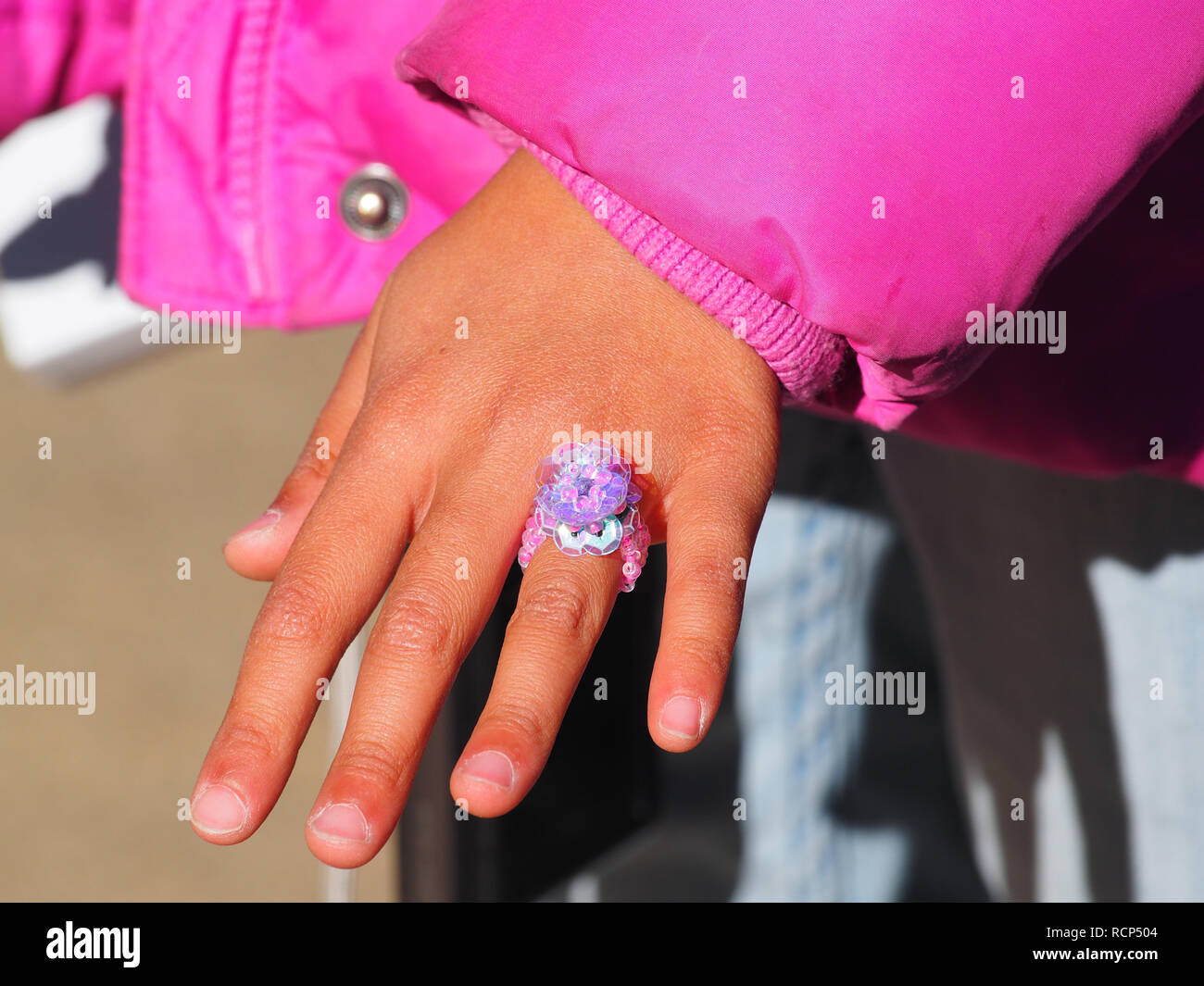 Little plastic ring kid bought from the gift shop at Huntington Library - Stock Image