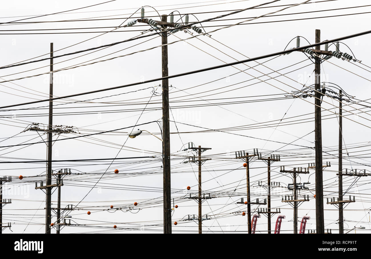 An overcast sky crisscrossed by many power and utility lines, south Seattle, Washington. - Stock Image