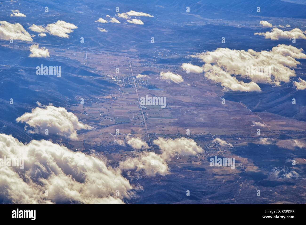 Aerial view of topographical Rocky Mountain landscapes on flight over Colorado and Utah during winter. Grand sweeping views of rivers, mountain and la - Stock Image