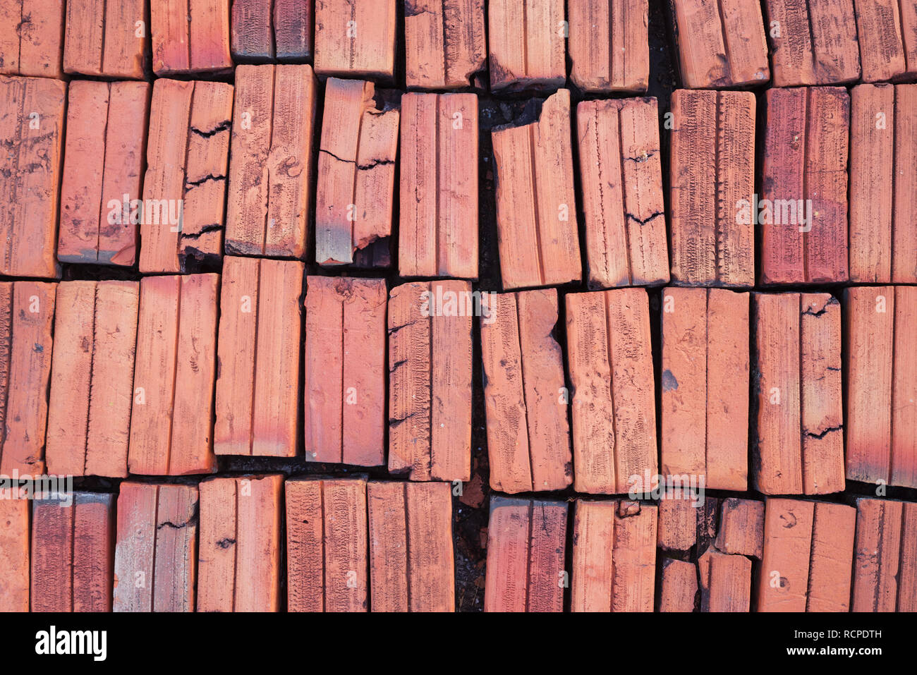 old red bricks laid out in a background array - Stock Image