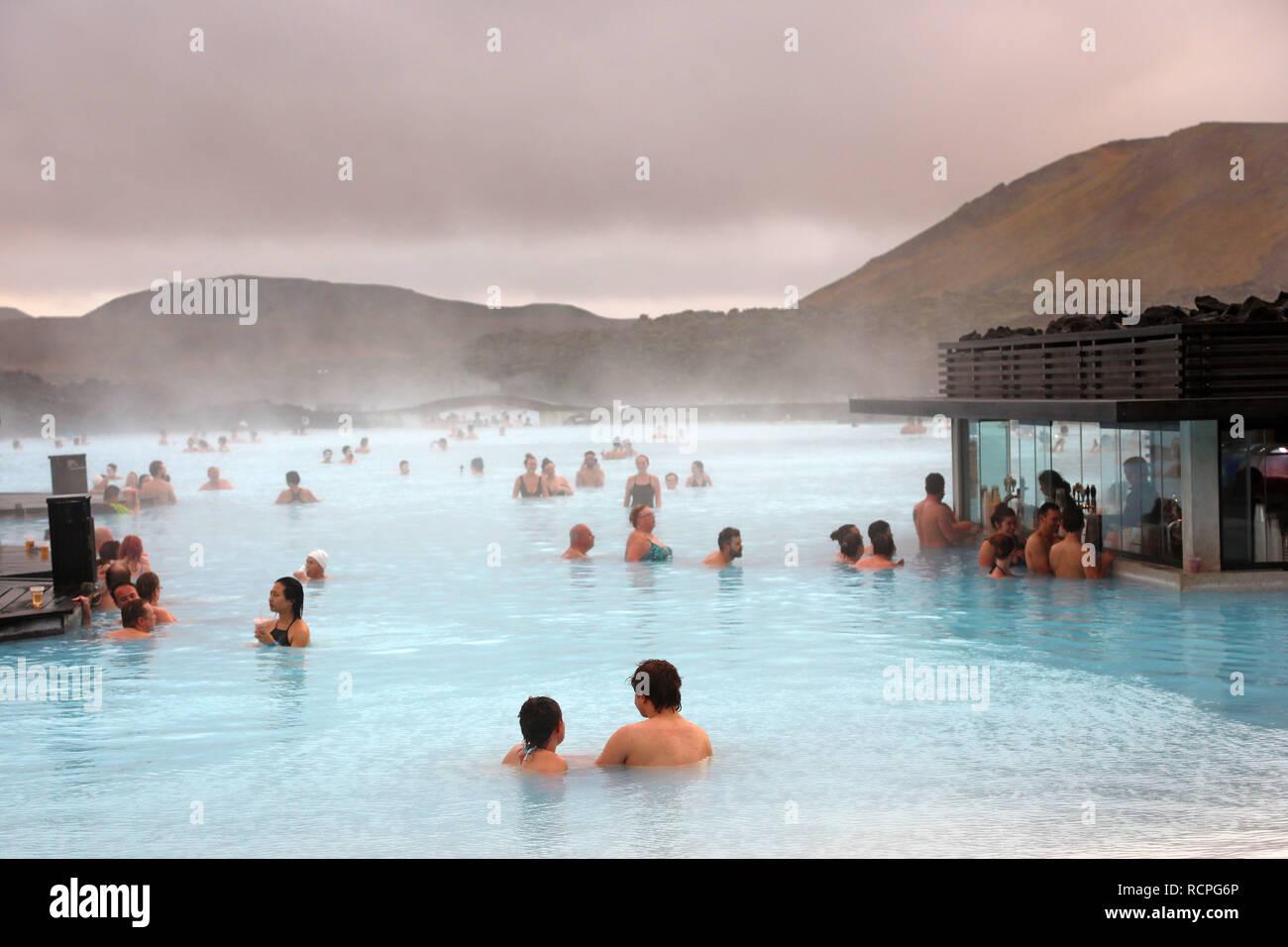 People bathing in the Blue Lagoon geothermal spa, Grindavik, Iceland - Stock Image