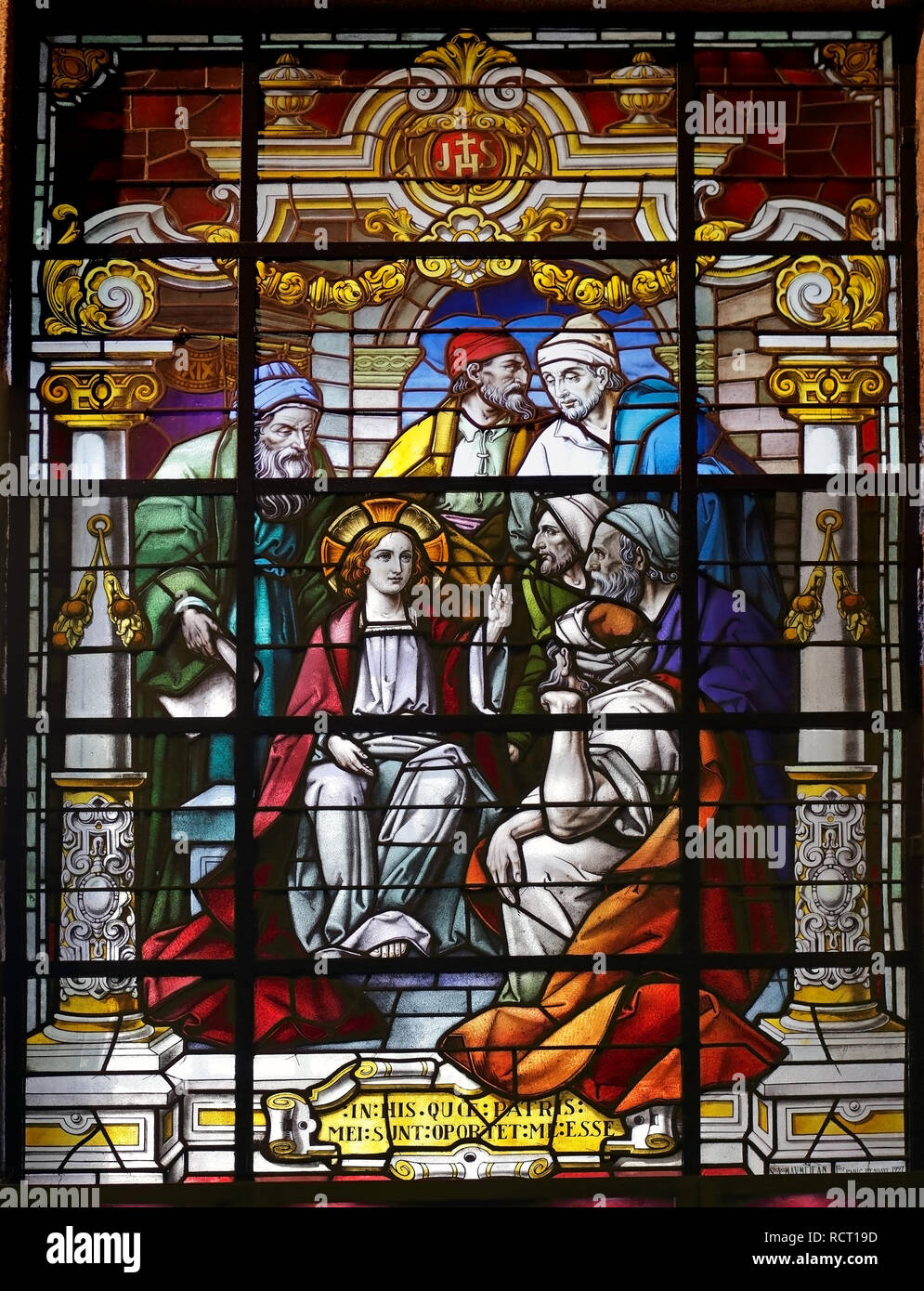 Porto, Portugal - March 23, 2015: Stained glass window from  church of Lapa representing a biblical scene from the New Testament, young Jesus among sc - Stock Image