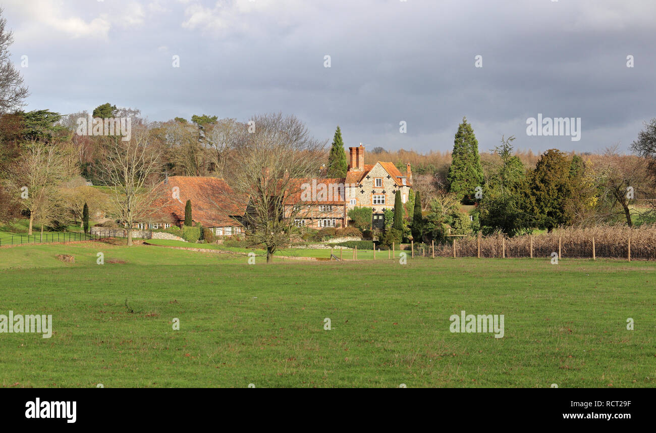 A Rural Landscape in the Chiltern Hills in Winter  with with Farm and Manor house - Stock Image