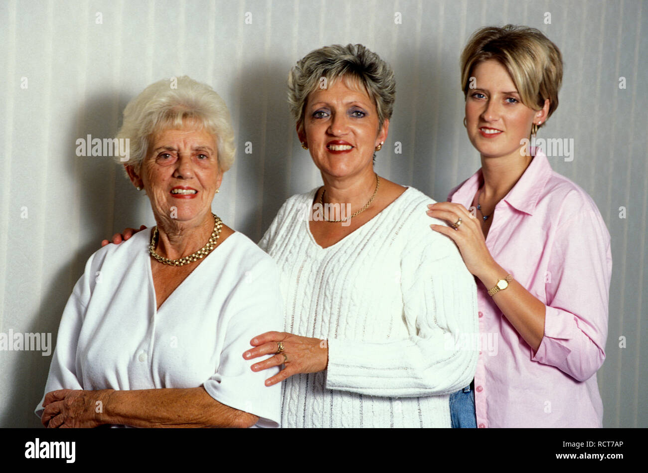 Three generations of women with similar features - Stock Image