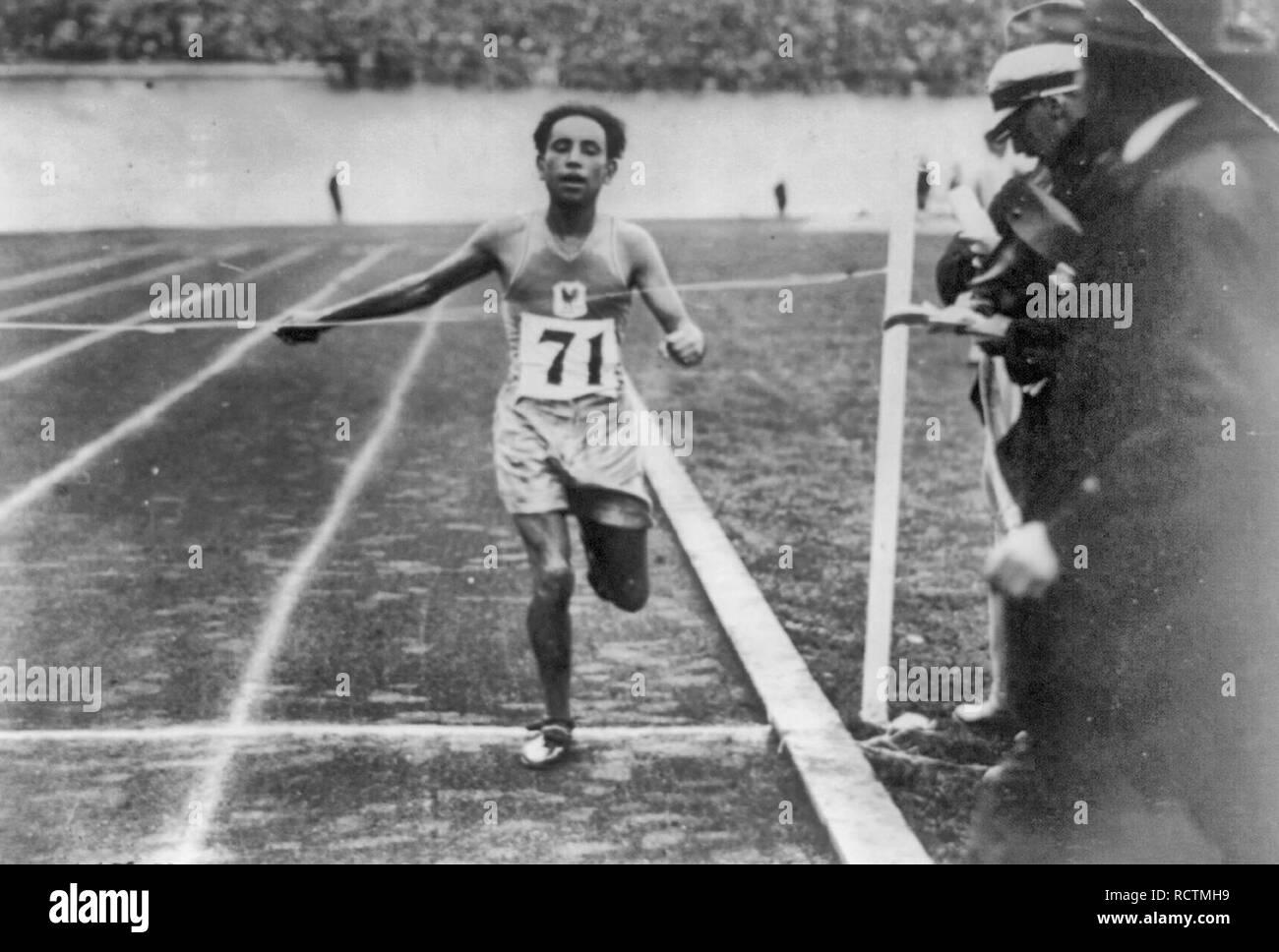 El Quafi of South Africa winning the Olympic marathon for France, 1928 - Stock Image