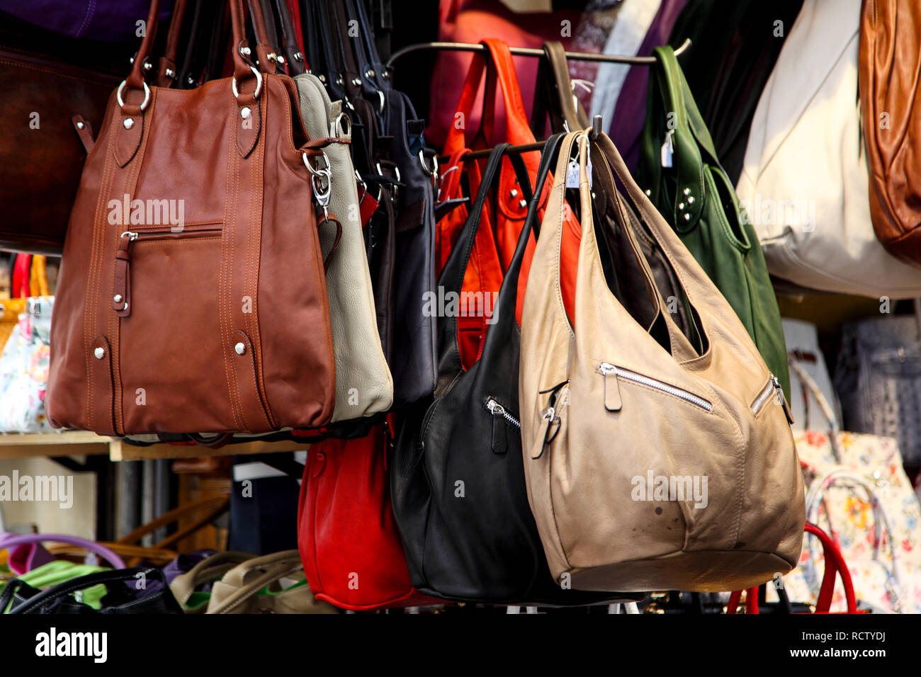 c6bfd98011 Leather handbags on display at Mercato Nuovo in Florence. - Stock Image