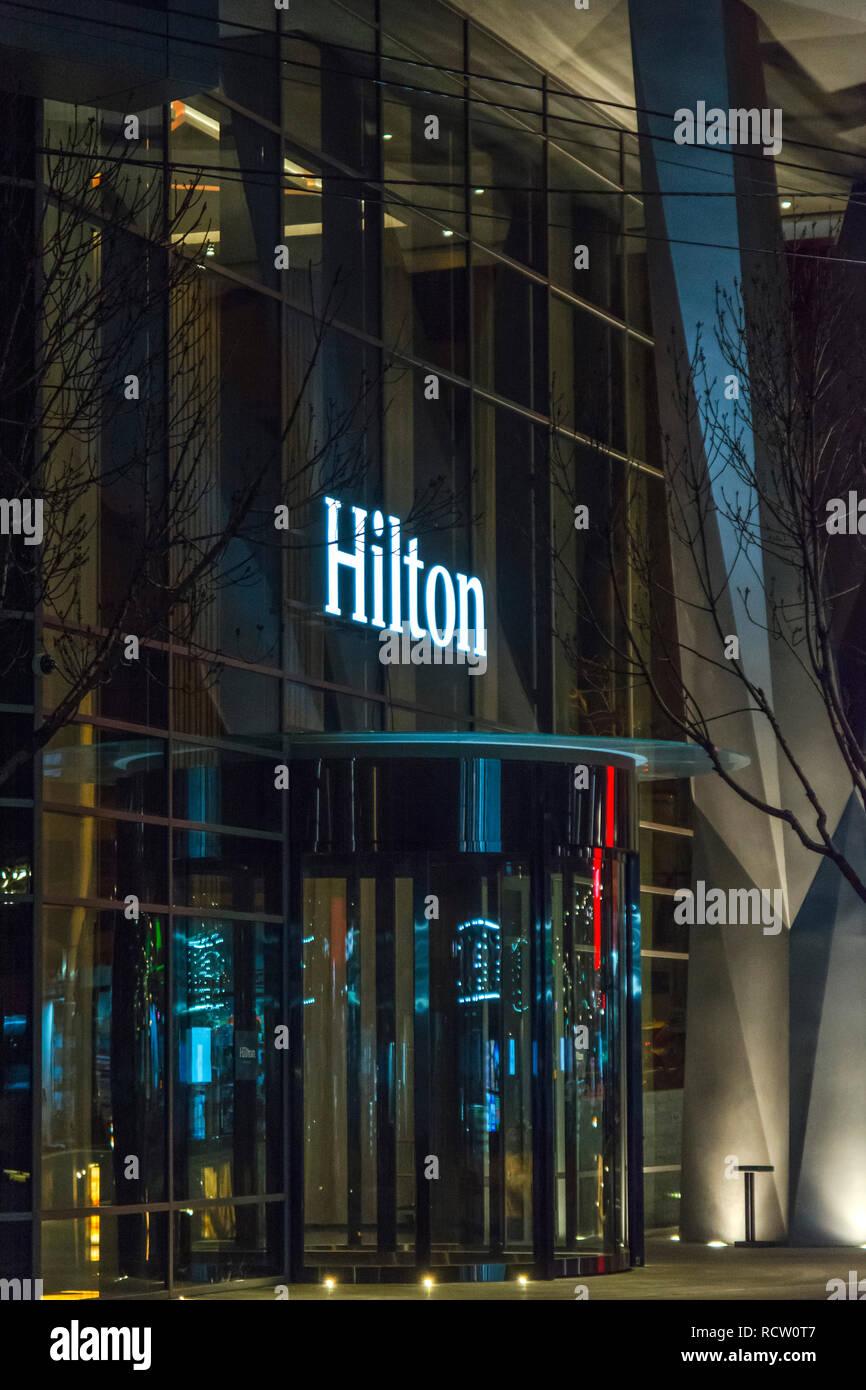 BELGRADE, SERBIA - MARCH 10, 2018 Hilton hotel entrance of building at night in Belgrade, Serbia - Stock Image