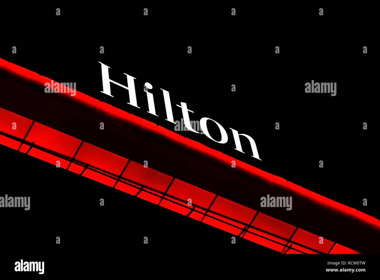 BELGRADE, SERBIA - MARCH 10, 2018 Hilton hotel logo on top of building at night in Belgrade, Serbia - Stock Image