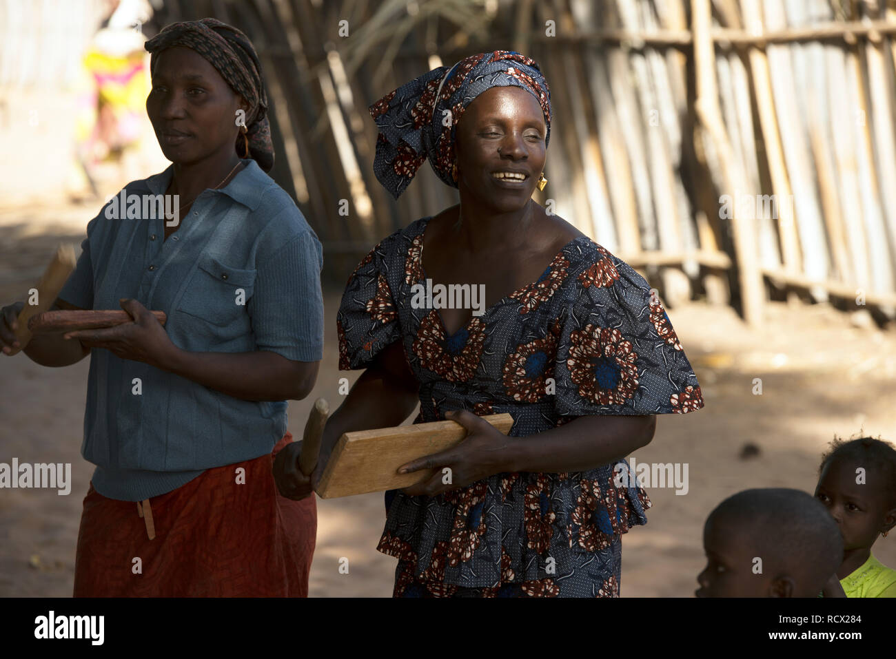 Indigenous Jola tribe women play traditional musical instruments during a chanting ritual in the village of Berending, The Gambia, West Africa. - Stock Image