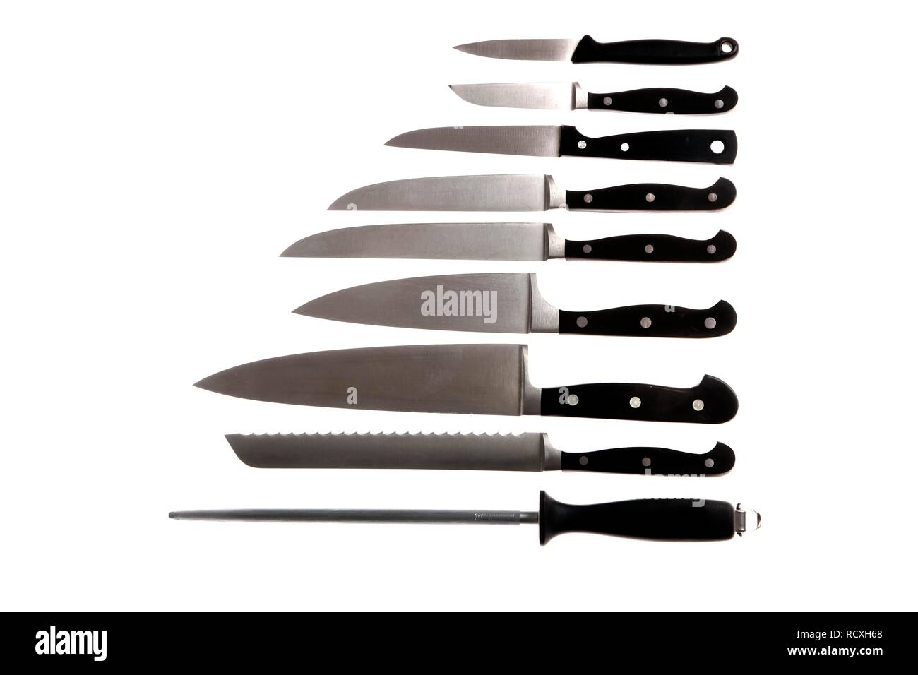 Various kitchen knives, sharpening steel, chef's knife, bread knife, filleting knife, vegetable knife - Stock Image