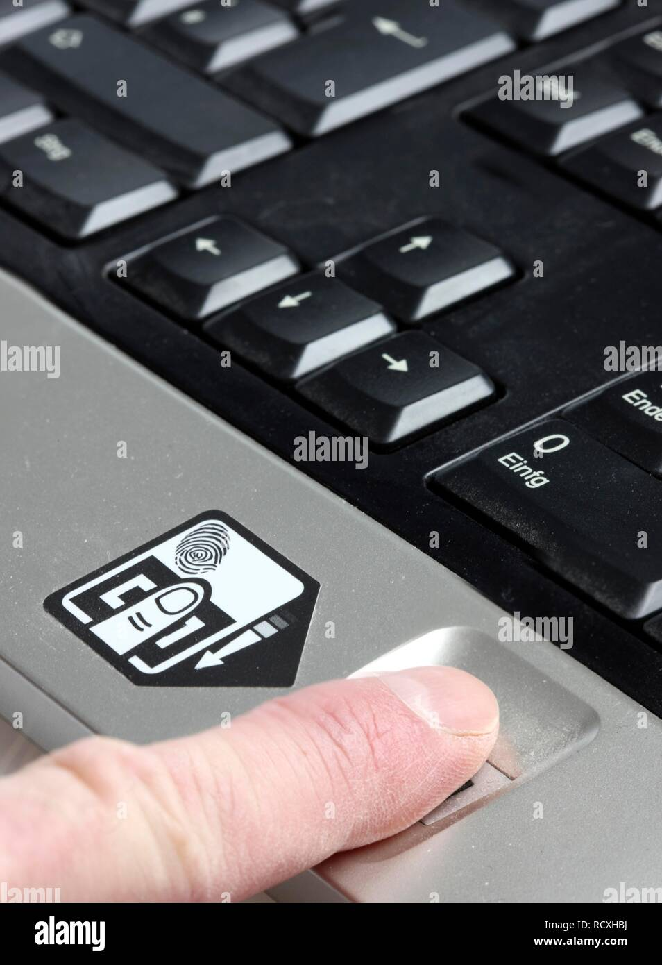 Computer keyboard with a fingerprint reader, only registered users can operate the computer after their fingerprint identifies - Stock Image
